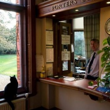 http://www.cambridgedream.com/wp-content/uploads/2015/03/Girton-Porters-Lodge-with-Buster-the-Cat.jpg